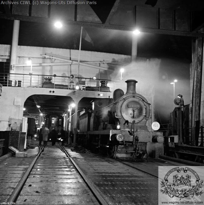 Wl the ferry boat from dover to dunkirk loaded with the night train carriages by a shunting locomotive 1952
